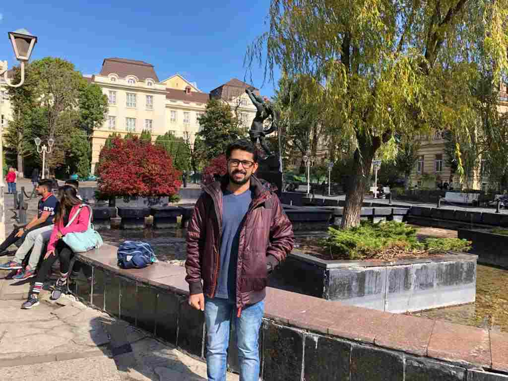 shobhit jayaswal standing outside the campus of lviv national medical university on a sunny day in the month of October 2019
