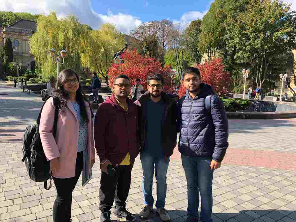 Shobhit Jayaswal with some students standing at the campus of Lviv National Medical University