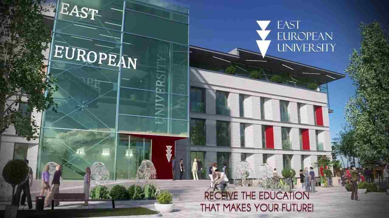Photo of the main building of East European University. Building colour is white and has big windows.